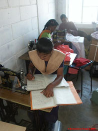 Young woman writing up Tailoring Class notes