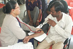 Blood pressure check at a Health Camp